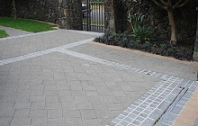 Adding new bassalt paver border to existing cobble stones